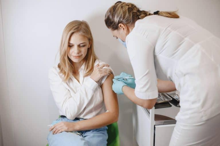 woman getting covid-19 vaccine